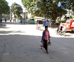 Walking down the main street of Nyaung U, Myanmar (Claire Backhouse) Tags: myanmar burma burmese woman women balance walking road street streetphoto streetphotographer life living shopping transport poor poverty