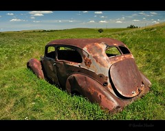 iron red (Gordon Hunter) Tags: rust red iron car auto old vintage paint decay abandoned derelict field prairies grass summer view trunk back vehicle canada gordon hunter nikon d5000 gord