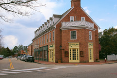 The Shoe Attic (danicalees) Tags: williamsburg virginia colonial march 2013 overcast cloudy trees winter exterior building yellow shoe attic cars street road shops shop store sky clouds crosswalk