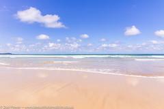 Gentle waves at Watergate Bay, Cornwall (Zoë Power) Tags: watergatebay ukcoast waves skyreflections mirror beach blueskies reflections sky seascape fluffyclouds cornwall cornishcoast sea