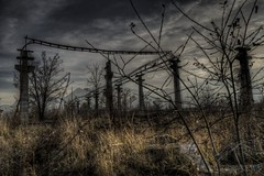 Wired Poles (Jan Fenkhuber Photography) Tags: urbex urban dark hdr photography abandoned exploration outdoors light sun romania brașov industrial sky cloud urbanexploration urbandecay urbandoned postapocalypse apocalypse poles wired wires