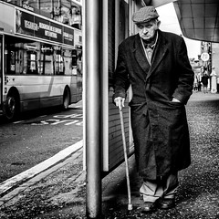 (Mister G.C.( Taking a 'Time Out' )) Tags: blackandwhite bw sonya6000 sonyalpha6000 mirrorless streetphotography urbanphotography candid street monochrome photograph image people man male elderly old walkingstick unposed urban town city sony a6000 35mmf18 sel35f18 35mm primelens schwarzweiss strassenfotografie glasgow scotland europe