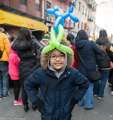 Don't hate me because I got a better hat than you daddy. (kuntheaprum) Tags: chinatownboston chinesenewyearcelebration yearofthepig sony a7riii tamron 2470mm f28 festival parade dragon firework