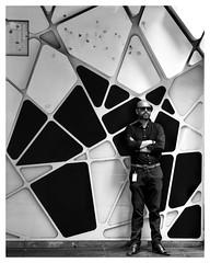 polygon man (gro57074@bigpond.net.au) Tags: bw streetphotography candidphotography candidstreet polygonman stphotographia australia 80 2470mmf28 tamron d850 nikon guyclift polygons shapes monotone monochrome mono blackwhite 2019 february cbd pittstreetmall sydney armscrossed crossedarms man