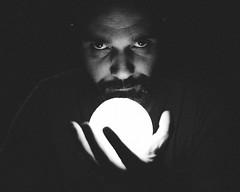 heart in hand (dark version) (theoswald) Tags: self shadows portrait eyes d3300 light nikon shapes people mood blackandwhite moody darkness 35mm selfportrait beard