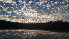 Sunset Clouds (Iforce) Tags: clouds landscape wallpaper sky reflection sunset trees lights mountains