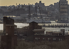 """East River Waterfront (Manhattan LES in Foreground and Skyline of Brooklyn In Background) (nrhodesphotos(the_eye_of_the_moment)) Tags: dsc35833001084 """"theeyeofthemoment21gmailcom"""" """"wwwflickrcomphotostheeyeofthemoment"""" waterfront eastriver brooklyn manhattan buildings sunlit docks cranes boat outdoors reflections shadows windows metal water landscape ships skyline"""