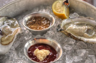 Raw Oysters on Ice with Sauces and Lemon