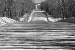 Winter Road (Edmonton Ken) Tags: road snow plowed trees shadows light bw hills undulate alberta