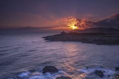 A new day (Enric.©) Tags: portdelaselva lighthouse dawn waves costabrava girona longexposure sun catalonia sky clouds landscape mediterranean sea