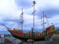 The new 2019 ship in Southport (rossendale2016) Tags: west resort tourist holiday popular logo unusual pier sea sand rides childrens emblem advertising model wooden tar old jolly rum bottle silver john long lads me ah rocks photo this thisphotorocks painted paint yellow green red sails sales renovated area parking galleon rope observation crowsnest roadside road flag ladder rigging rig 2019 promenade beach pleasure new pirate merseyside lancashire southport ship