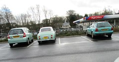A Trio of Old Green Cars (occama) Tags: old cars cornwall uk nissan figaro 1991 audi estate 1997 honda jazz 2004 green group lineup supermarket mundane unexciting winter grey clouds urban suburban
