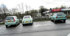 A Trio of Old Green Cars (occama) Tags: old cars cornwall uk nissan figaro 1991 audi estate 1997 honda jazz 2004 green group lineup supermarket mundane unexciting winter grey clouds urban suburban