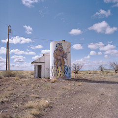 mountain man / route 66. two guns, az. 2007. (eyetwist) Tags: eyetwistkevinballuff eyetwist twoguns arizona kamp gunslinger mountain man fur watertank abandoned route66 arsenalukraine kiev60 kiev ultracolor kodak ultracolor400uc 400uc ishootfilm ishootkodak analog analogue film emulsion mamiya6 square 6x6 120 mediumformat filmexif epsonv750pro 6 desert highdesert landscape motherroad us66 route 66 roadsideamerica americana typology lonely desolate middleofnowhere vacancy closed getyourkicksonroute66 clouds campground guns shotgun cowboy mural art graffiti tagurbex