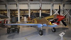 "Curtiss P-40N Kittyhawk Mk.IV c/n 29863 Australia Air Force serial A29-556 preserved as RAF ""FX760"" code P-GA (sirgunho) Tags: royal air force raf museum hendon london england united kingdom preserved aircraft aviation curtiss p40n kittyhawk mkiv cn 29863 australia serial a29556 fx760 code pga"
