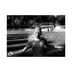 """ Girls'Training..."" (jcois.) Tags: pentax portrait streetportrait street regard blackwhite bw noirblanc monochrome urbain urban people personnes jcois streetphotographer rouen portraitderue soccer football champ pelouse stade"