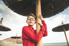 DSC_8887 (IILife) Tags: young boy red dreaming dream eyes closed beach sea ocean palaces umbrella sky clouds summer spring winter caucasian island vacation travel holiday outdoor alone portrait nikond5