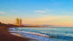 A la platja de La Barceloneta (Fnikos) Tags: sea water wave waterfront beach shore seashore synny sunset sand coast sky cloud skyline bird seagull city tower building architecture peix rock mountain bay tree palmtree nature outdoor