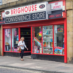 Brighouse 005 (Peter.Bartlett) Tags: bag shopfront unitedkingdom people streetphotography doorway westyorkshire colour peterbartlett doubleyellowlines urban candid uk m43 microfourthirds shopwindow sign woman walking olympuspenf brighouse england gb