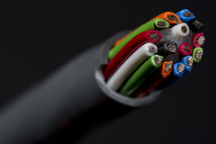 Something colorful wrapped in grey -[ HMM ]- (Carbon Arc) Tags: macromondays redux2018 multicolor multicolour cable wire electronic red orange green blue grey gray white black connection lead round electrical industrial