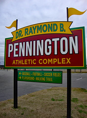 Pennington Athletic Complex Sign. (dccradio) Tags: lumberton nc northcarolina robesoncounty outdoor outside outdoors park citypark northeastpark drraymondbpenningtonathleticcomplex penningtonathleticcomplex january winter saturday saturdayafternoon afternoon goodafternoon sony cybershot dscw230 sky overcast cloudy flag flags yellowflag sign words text color colorful baseball football soccer playground walkingtrail