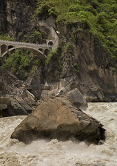 Tiger Leaping Gorge And Jinsha River, Lijiang, Yunnan Province, China (Eric Lafforgue) Tags: a0007896 asia china colorpicture day deep flowing forest groupofpeople highangleview jinshariver lijiang mountain nature outdoor powerinnature ravine realpeople rock tigerleapinggorge vertical yangtzeriver yunnan yunnanprovince