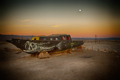 Nomad Clan (Maureen Bond) Tags: ca roadtrip maureenbond saltonsea salt mud dyingsea bombaybeach sunset twilgjt moon fullmoon clouds poles wires rocks boat drydock shipwrecked