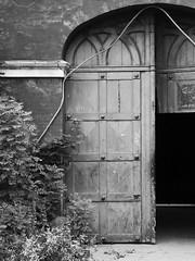 Old Doors (Nick Condon) Tags: architecture blackandwhite christiania copenhagen denmark door olympus45mm olympusem10 absoluteblackandwhite olympus
