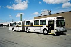 63047 - Halifax Regional Municipality (Metro Transit) 704 - Dartmouth, Burnside - 28 Jun 2004 (Busman Extraordinaire) Tags: halifaxmetrotransit halifaxtransithistory burnsidetransitcentre articulatedbus