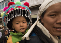 Kid In Traditional Costume During A Funeral Procession, Yuanyang, China (Eric Lafforgue) Tags: 23years a0006720 asia china chineseculture colorpicture costume custom day deadperson death event family funeral headdress headwear horizontal lookingatcamera mourning oneparent outdoors parade realpeople religion taoism traditionalclothing traditionalculture twopeople twopersons yunnan yunnanprovince yuanyang