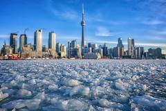 Toronto on the Rocks (Paul Flynn (Toronto)) Tags: toronto harbour harbor ice sky skyline city cityscape winter frozen waterfront water february