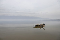 lonely journey (dim.pagiantzas | photography) Tags: water waterscape landscape boat transportation reflections nature lake mountains sky clouds fog foggy textures wood wooden trees ambient light