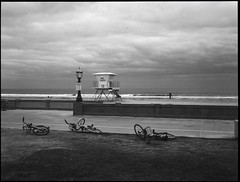 Three Bicycles (greenschist) Tags: zenzanonrf65mmf california usa rolleiretro400s 6x45 bicycles pacificocean people mediumformat blackwhite bronicarf645 analog missionbeach film clouds