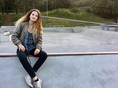 Girl Sitting at a Skate Park Looking at Camera (Jonatan Svensson Glad (Josve05a)) Tags: cute child happy smiling people smile caucasian happiness looking childhood kid women person human pretty cheerful fun joy outdoors youth play playful playing outdoor children activity kids playground younggirl 14years