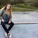 Girl Sitting at a Skate Park Looking at Camera