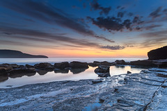 Dawn, Rocks, Reflections and Wispy Clouds Seascape (Merrillie) Tags: daybreak sunrise cloudy australia nsw centralcoast clouds sea newsouthwales rocks earlymorning morning water landscape ocean nature sky waterscape coastal seascape outdoors killcarebeach dawn coast killcare waves