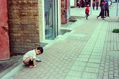 Thug Life (hiphopmilk) Tags: copyright©jaredyehwooehmoehfilms konica offroad 現場監督 zoom 35mm 135film film analog analogue jaredyeh hiphopmilk kodak travel china sichuan aba hongyuan tibetan qiongxi kid child street dump shit poo stool bowel neighborhood