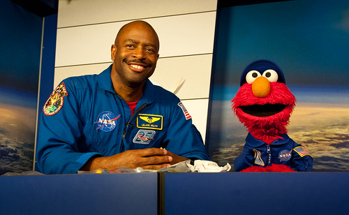Astronaut Leland Melvin speaks with Elmo