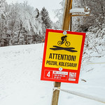 Attention sign at Bike park Pohorje in winter thumbnail