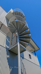 Whale watching tower on private home (Malcom Lang) Tags: tower whale watching house stairs spiral wall tin steps pole steel metal roof rails sky canon powershot canonpowershot mk11 north stradbroke island queensland australia australian aussie travel traveling travelaustralia building blue veranda