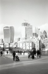 Photo of a Photo 2 (Myahcat) Tags: london 35mm film bw blackandwhite kosmophotomono mono yashica yashicafri winter street city inception photoofaphoto streetphotography skyline tourists filmphotography