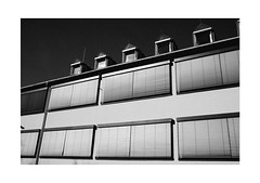 Sun-Shields (Thomas Listl) Tags: thomaslistl blackandwhite biancoenegro noiretblanc monochrome sky 35mm sunlight contrasts grey dark architecture facade windows lines geometry building urban city