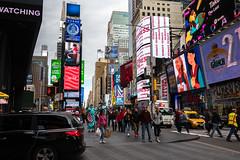 Watching... You (Jocey K) Tags: sonydscrx100m6 triptocanadaandnewyork architecture buildings street people words signs sky clouds timessq billboards streetperformers taxi cabs