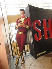 Shazam Theater Lobby Standee 34th Street NYC 4813 (Brechtbug) Tags: shazam theater lobby billboard 34th street new captain marvel the big red cheese poster ad nyc 2019 times square movie billboards york city work working worker paint painting advertisement dc comic comics hero superhero alien dark knight bat adventure national periodicals publication book character near broadway shield s insignia blue forty second st fortysecond 03302019 lightning flight flying march amc loews