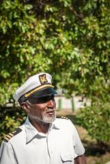 The Captain Awaits (dtravano) Tags: citylife streetscene urbanstyle bahamas nassau strawmarket colorsandtones lightsandshadows photooftheday streetphotography nikond3000 50mmlens