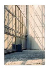 One lonely Eye (Thomas Listl) Tags: thomaslistl color budapest hungary 100mm architecture windows shadow lightandshadow graphical geometry camera bin wall light reflection mirror urban city
