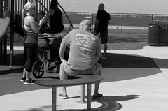 Guy Harvey takin' a break (Twila1313) Tags: guyharvey bald man sitting streetphotography park monochrome tshirt blackandwhite blackwhite panasoniclx7