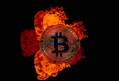 Golden Bitcoin on fire over black background (wuestenigel) Tags: market smoke broken background bitcoin burn crash flame coin bear money mining btc digital cryptocurrency black bussiness finance bullmarket fire flames burning illustration design desktop symbol abstract abstrakt flamme art kunst shape gestalten element decoration dekoration graphic grafik noperson keineperson vector vektor luminescence lumineszenz gold vintage jahrgang pattern muster dark dunkel hot heis sign zeichen
