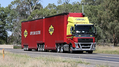 Well Knowns (3/3) (Jungle Jack Movements (ferroequinologist)) Tags: man logistics linfox booth wine kenworth t volvo fh newell highway nsw new south wales parkes melbourne sydney brisbane hp horsepower big rig haul haulage freight cabover trucker drive transport carry delivery bulk lorry hgv wagon road nose semi trailer deliver cargo interstate articulated vehicle load freighter ship move roll motor engine power teamster truck tractor prime mover diesel injected driver cab cabin loud rumble beast wheel exhaust double b grunt g1