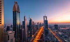 Rushing Dubai (andreasmally) Tags: sheik zayed road sky skyline skyscraper wolkenkratzer himmel abend sunset sonnenuntergang dubai vereinigte arabische emirate united arab emirates